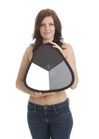 Beautiful model holding photographic grey white balance card