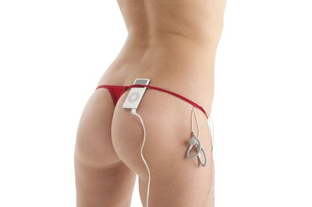 Beautiful woman in red bikini with personal stereo and headphones Stock Photo - 5486916