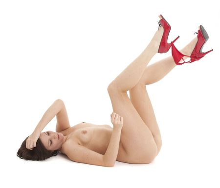 nude babe: Beautiful nude woman in high heels playing with her red panties Stock Photo