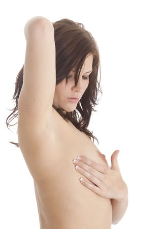 Beautiful brunette examining her breast with nipple showing photo