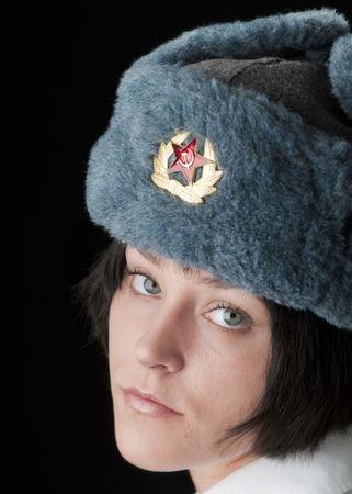 Beautiful brunette woman in Russian fur hat