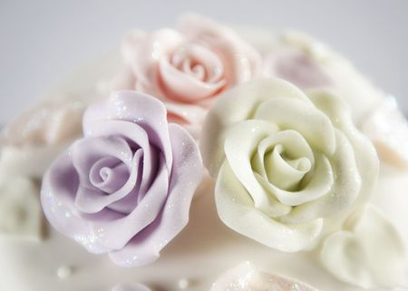 Beautiful wedding cake with rose icing decorations