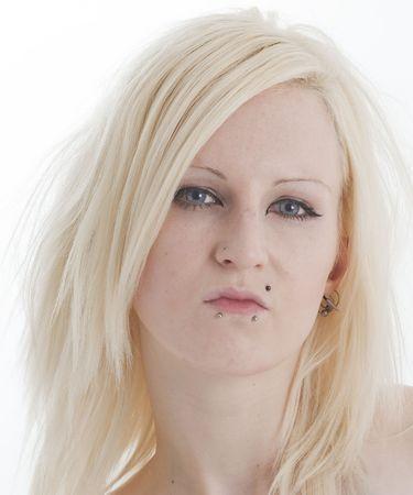 Beautiful blonde pierced woman looking sulky