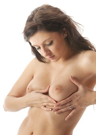 Beautiful nude woman medical examining her breasts for lumps Stock Photo - 11513089