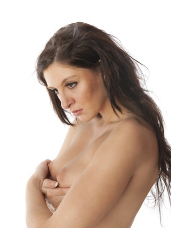 Beautiful nude shy woman covering her breasts Stock Photo - 11513088