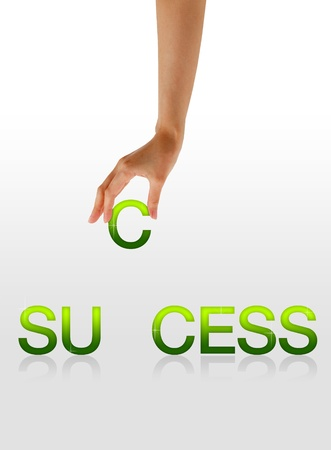 surpass: High resolution graphic of a hand holding the letter C from the word success.