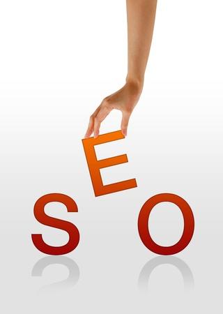 seo: Hoge resolutie afbeelding van een hand met de letter e van het woord SEO. Stockfoto