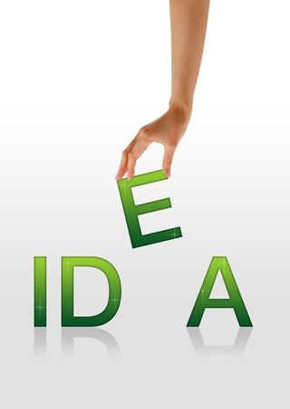 opinions: High resolution graphic of a hand holding the letter E from the word Idea. Stock Photo