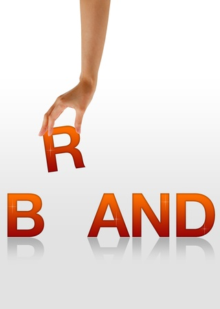 brand name: High resolution graphic of a hand holding the letter R from the word Brand. Stock Photo