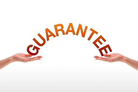 quality assurance: High resolution graphic of hands holding the word guarantee.