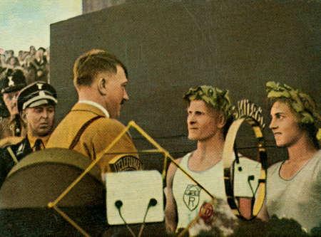 adolf hitler: CIRCA. 1933: Rare German vintage cigarette card from ca. 1933 Der Staat der Arbeit und des Friedens album.