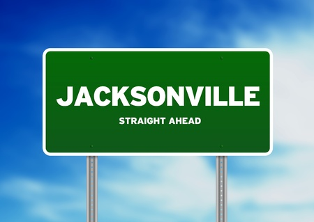 highway sign: Green Jacksonville, Florida, USA highway sign on Cloud Background.  Stock Photo