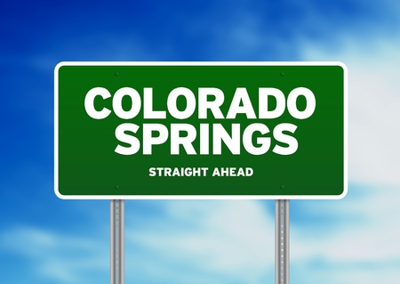 Green Colorado Springs, Colorado, USA highway sign on Cloud Background.  photo