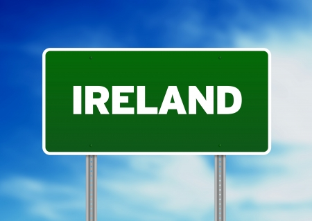 highway sign: Green Ireland highway sign on Cloud Background.  Stock Photo