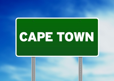 green background: Green Cape Town highway sign on Cloud Background.  Stock Photo