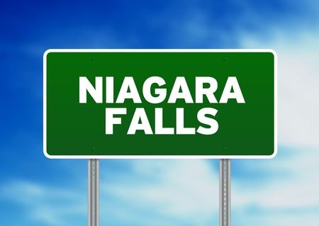 Green Niagara Falls highway sign on Cloud Background.  photo