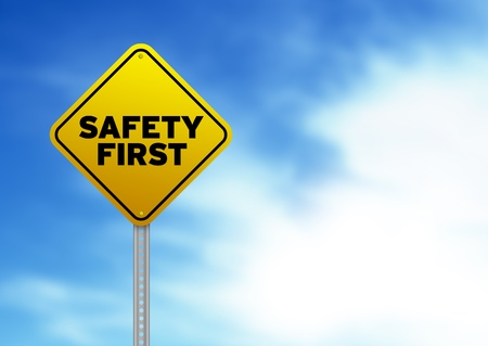 High resolution graphic of a yellow Safety First Road Sign on Cloud Background.  photo