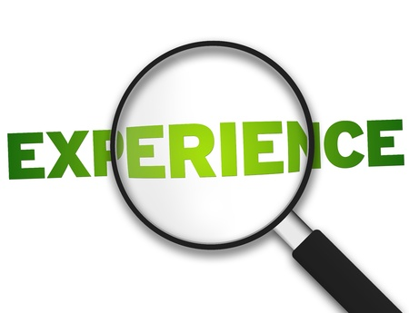 experience: Magnifying Glass with the word experience on white background.