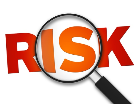 liability: Magnifying Glass with the word Risk on white background. Stock Photo