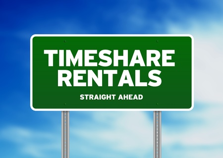 timeshare: Green Timeshare Rentals highway sign on Cloud Background.