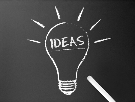 Dark chalkboard with a ideas light bulb illustration. Stock Illustration - 10322844