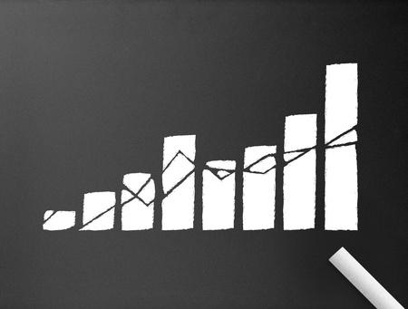 Dark chalkboard with a business graph illustration.  illustration