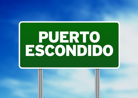 oaxaca: Green Puerto Escondido, Oaxaca, Mexico highway sign on Cloud Background. Stock Photo