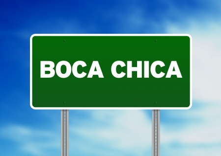chica: Green Boca Chica, Dominican Republic highway sign on Cloud Background. Stock Photo