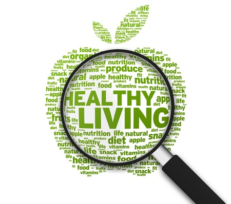Magnified Apple with the words Healthy Living on white background. photo