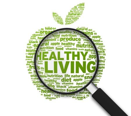 Vergrote appel met de woorden gezond leven op witte achtergrond.