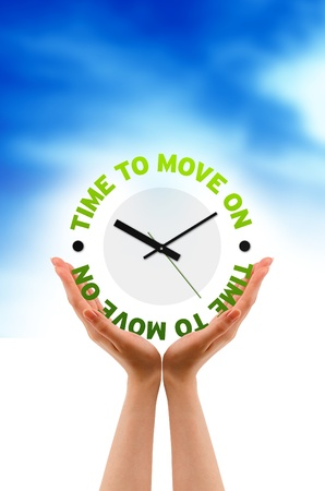 move ahead: High resolution graphic of hands holding time to move on clock. Stock Photo