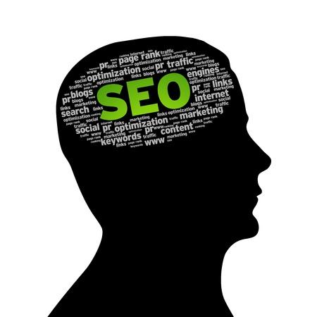 seo: Silhouette hoofd met een SEO-woord wolk op een witte achtergrond. Stockfoto
