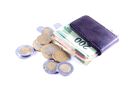 coin purse: Varios Mexican Pesos bank notes and coins on white background
