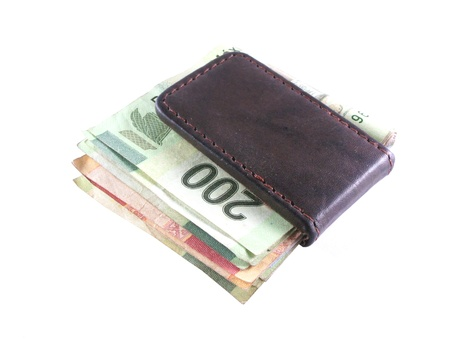 Money clip with various mexican bank notes photo