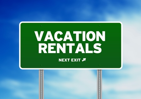 rentals: Green Vacation Rentals highway sign on Cloud Background.