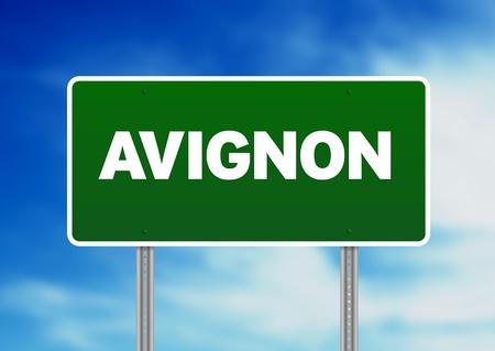 avignon: Green Avignon, France highway sign on Cloud Background.  Stock Photo