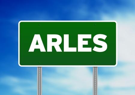 arles: Green Arles, Provence-Alpes-Côte dAzur, France highway sign on Cloud Background.  Stock Photo