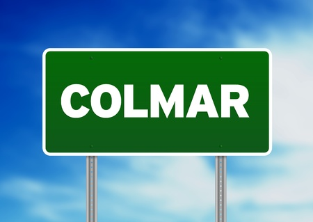 colmar: Green Colmar, Alsace, France highway sign on Cloud Background.  Stock Photo