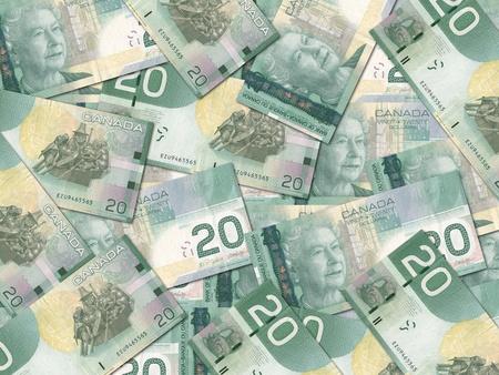 randomly: Canadian dollar bills scattered randomly all over.  Stock Photo
