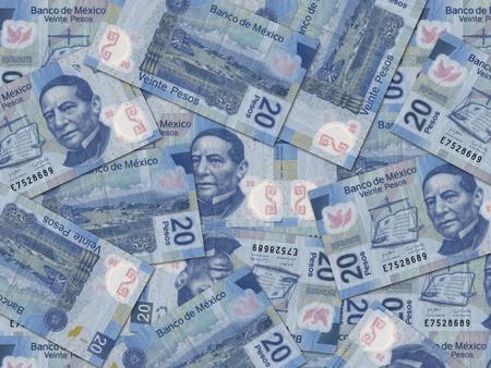 randomly: 20 Mexican Peso bills scattered randomly all over.