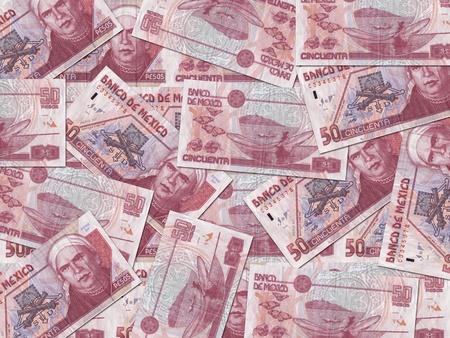 randomly: 50 Mexican Peso bills scattered randomly all over.  Stock Photo