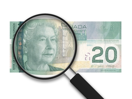 canadian currency: Magnifying Glass with a 20 Canadian Bank Note on white background Stock Photo