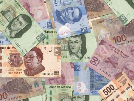 pesos: Mexican Peso bills scattered randomly all over.