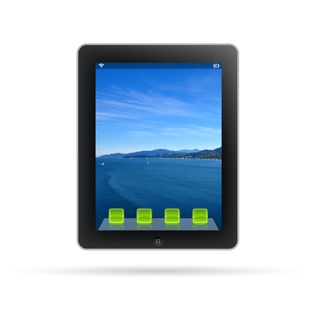 Tablet PC with lanscape background isolated on white. photo