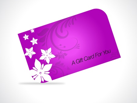 Roze giftcard met florale elementen op grijze gradiant achtergrond.