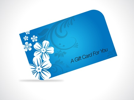 Blue giftcard with floral elements on gray gradiant background.