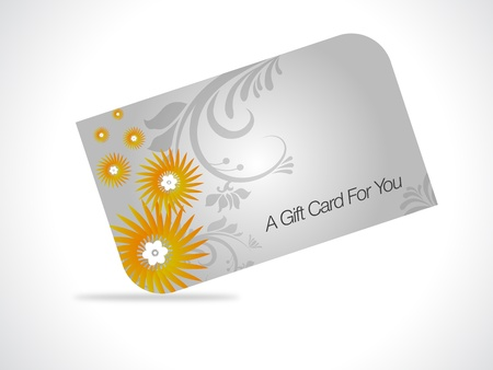 Giftcard with yellow floral elements on gray gradiant background.