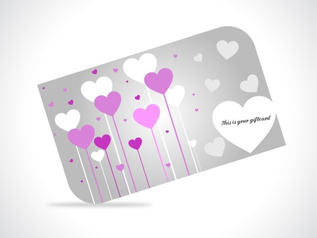 Giftcard with hearts on gray gradiant background.  Vector