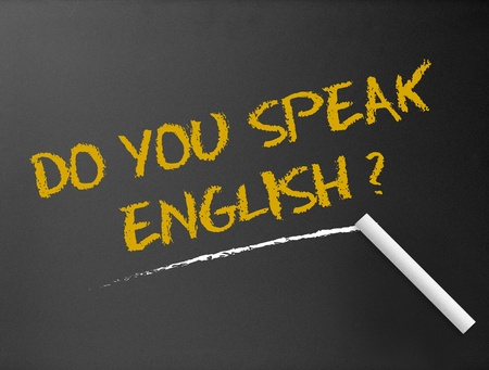 learn english: Dark chalkboard with a question. Do you speak English?