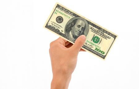 Hand holding 100 US Dollar Bill islolated on white background. photo